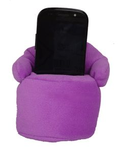 This soft mobile phone chair is a perfect accompaniment to any mobile phone. Looks great on any office desk or bedside table. Can fit phones with a width of up to 6cm.  Available in 6 different colours.