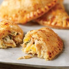 Cheesy Chicken tucked into pockets make delicious empanada's. Try fresh cilantro and chipotle flavored mayo tucked in make it even better!