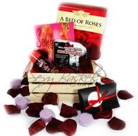 Perfect Valentines Gift!!  Www.sexybaskets.com    This romantic bed of roses basket includes: *Rose petals with tea light candles and an invitation card *Vibrating dual cockring *Bath salts with floating cards for fun in the tub *Wet 4-in-1 Strawberry oil (massage, lubricant, edible, and warming)  Comes wrapped in a gift basket.