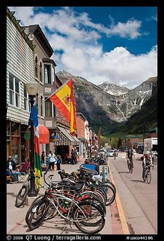 Mountain bikes parked on main street sidewalk. Telluride, Colorado, USA