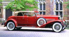 1931 Duesenberg Model J Dual Cowl Torpedo Phaeton Red Fsvr - If I was disgustingly wealthy I buy a Duesenberg or Auburn just to tool around in.