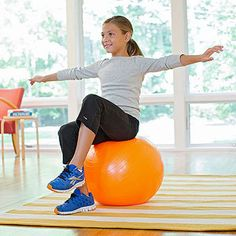 On Top of the World: This simple challenge is a great way to teach balance and improve posture and to work core muscles, says Steve. Have your child sit up straight and focus on keeping her tummy muscles tight. See if she can lift each foot a few inches off the ground for ten seconds. Now go for the record: how long can she hold both feet up? (Spot her from behind if needed.)
