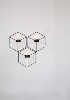 POV wall-mounted and table-top wire candle holders with optical illusion by Note Design Studio of Sweden for Danish design brand Menu. Design Shop, Note Design Studio, Notes Design, Menu Design, Diy Wall Lamp, Chandeliers, Tea Lights, Wall Lights, Wall Candle Holders