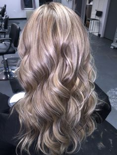 Ash blonde wavy cool lowlights and highlights