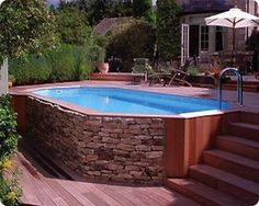 Above Ground Pool Landscaping | This 15×30 Grecian pool has a look of an inground pool, and the ...