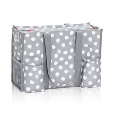 Zip-Top Organizing Utility Tote (U R U) in U R U Swirl Dot for $35 - This versatile tote is one of our top sellers. With seven exterior pockets and a zipper to keep everything safe and secure, it's the perfect bag to keep you organized on the go. Via @thirtyonegifts