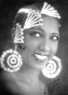 Jospehine Baker was famous for dancing the Charleston and was a favourite of Ernest Hemingway. Her stage costumes and those of the flapper girls dripped with Swarovski crystal and beads, catching the light and exploding with sparkle.  #crystalcouture #1920s #Paris