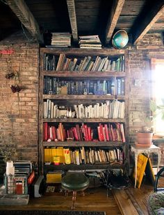 love the exposed brick built in book shelf...and its color coded AMAZING!!!