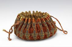 Gaming purse Date: late 17th century Culture: French Medium: silk, leather, metal, wood Accession Number: 2009.300.2065