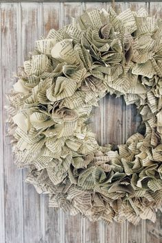 "Book page wreath; successfully did this using probably 400, 4"" squares (just cut the page in half) on a 16"" foam wreath. Could try smaller squares on a smaller wreath form, and lighter weight craft paper (not construction or tissue paper) in different colors to mix it up."