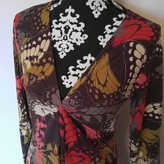 """CAbi modal butterfly dress NWOT Women's CAbi long sleeve dress. Knotted at bust. Beautiful multi color butterfly print. Extremely soft and comfortable. 57% cotton, 38% modal, 5% spandex. Stretchy. Size large. NWOT never worn.  Measurements laying flat NOT stretched:  Shoulder to shoulder: 16"""" Underarm to underarm: 17.5"""" Length: 41"""" CAbi Dresses"""