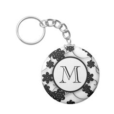 This cute, mod black flowers pattern keychain with swirls is a perfect background for a circle tag with your initial on it in black text in an elegant font. Personalize this fun, girly design with your monogram.