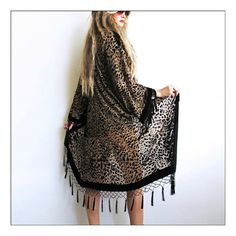 This one's for the wild child's! Stunning leopard kimono with a vintage vibe. Gorgeous luxe velvet burnout with tassels dripping down the f...