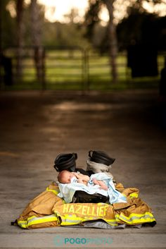 newborn in firefighter gear!  LOVE THIS!  Why didn't Patch fight fire back when we had babies... oh, that's right, his wife didn't want him to... what a bad wife!