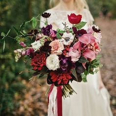 Autumnal wedding inspiration over on @lovemydress. Link in profile!  This was Alexa's bouquet tied with with blush silk burgundy and gold sequins. #weddingplanning #weddingflowers #weddingflorist #autumnwedding #autumn #masala