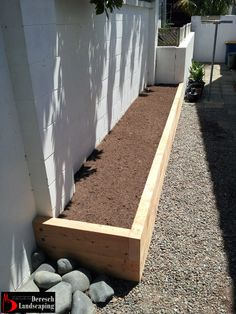 raised planterbed made of macrocarpa sleepers - design and construction by Deresch Landscaping - DL13041-01-0013