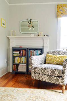 bookshelves inside a fireplace