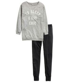 H&M. Pyjamas comprising an oversized top in sweatshirt fabric and jersey leggings. Long-sleeved top with ribbing at the cuffs and hem and soft brushed inside. Leggings with an elasticated waist and ribbed hems. Grey and black.