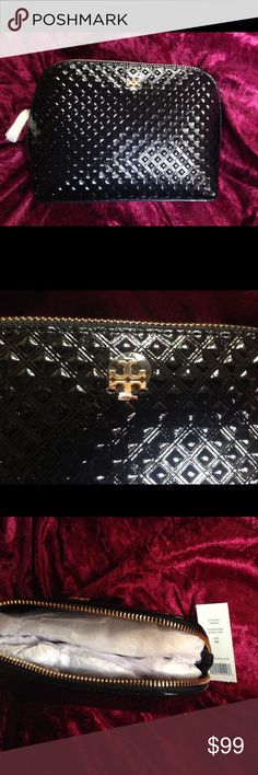 Authentic Tory Burch Make Up Bag New Authentic Tory Burch make up bag. New with rapping still on zipper. Such a beautiful bag Tory Burch Bags Cosmetic Bags & Cases
