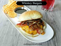 Whiskey Burgers smothered in melted cheese, bacon, sauteed onions and mushrooms, topped with a sweet glaze with a kick! | cookingwithcurls.com | #burgerrecipes #whiskeyglaze