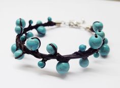 Turquoise  woven together dark brown leather Bracelets. $6.80, via Etsy.