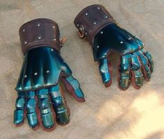 Sexy blued finger gauntlets.
