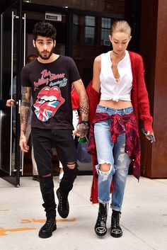 Zayn Malik and Gigi Hadid (Zigi) pulling together their best grunge get-ups. Him: Rolling Stones T-shirt, black, ripped skinny jeans. Her: a knotted vest, mohair cardigan (shrugged off the shoulder, natch), ripped boyfriend jeans and clompy boots