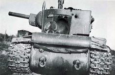 Padded Thais under a Soviet tank KV-2 from the 1st Armored Division of the Leningrad Front