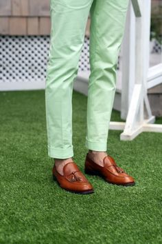 green trousers, cognac tassel loafers