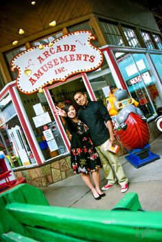 Engagement couple photoshoot in Manitou Colorado Springs in a penny arcade popcorn fun colorful shoot with ashley Tyler Studios Tyler photography cute