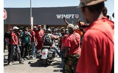 Picture of a Dogs of War members on their motorcycles in Senekal, while driving past an angry mob of EFF members at the bail hearing for two suspects in the brutal farm murder of Brendin Horner