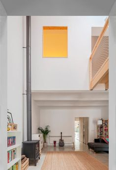 On the ground floor, the entrance leads through a study area into a large, double-height living area, with simple finishes including a log burner with an exposed flue. Patio Interior, Keep The Lights On, Ideal Tools, Sit Back, Contemporary Architecture, Cladding, Minimalism, Indoor, Gallery