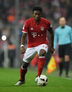 David Alaba of Muenchen controls the ball during the Bundesliga match between Bayern Muenchen and Bayer 04 Leverkusen at Allianz Arena on November 26, 2016 in Munich, Germany.