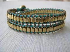 leather and brass wrap bracelet - double wrap, quality leather, turquoise, silk thread, button closure. $70.00 CAD, via Etsy.
