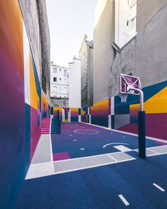 In a unique collaboration between French fashion brand Pigalle and design agency Ill-Studio, the Paris Duperré basketball court was recently redesigned and repainted with a vibrant new color scheme. The narrow basketball court is nestled between two apartment buildings in the 9th arrondissement and