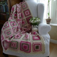 The colours in this blanket are gorgeous...love the chair too!