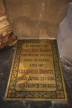 A memorial plaque marking where the Bronte Sisters are buried in the Bronte Chapel of Haworth Parish Church next to the Bronte Parsonage Museum in Haworth, England.