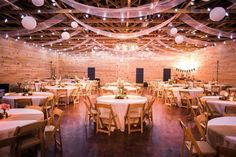 Rustic wedding reception decor idea - blush linens, string lights, round tables covered in white linens and burlap runners, and wooden folding chairs {Christopher Helm Photography}. #afairytalewedding #weddingdecor #weddingplanning #weddngdesign #floraldesigner
