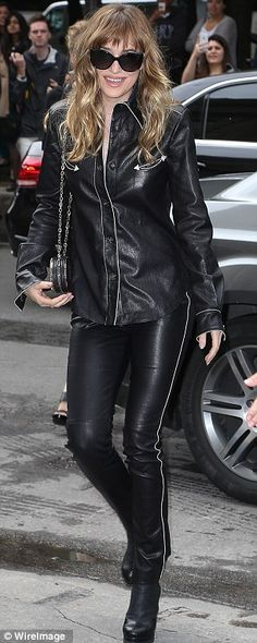 Dakota Johnson cuts an eye-catching figure in head-to-toe leather #dailymail