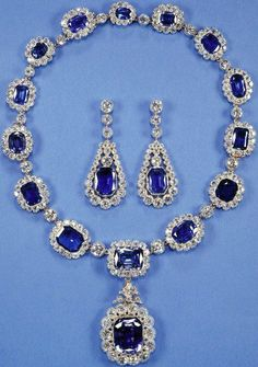 "King George VI's Victorian Suite"". Made around 1850, purchased by King George VI of Great Britain, who presented it to his daughter princess Elizabeth of Great Britain when she married prince Philip of Greece in 1947. It is a necklace of sixteen sapphires surrounded by diamonds, and a pair of earrings. In 1952, Queen Elizabeth II had it shorten by removing the largest and three of the smallest stones. Since 1959 the largest one is used as a pendant , but it can also be used as a brooch."