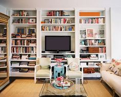Little Green Notebook: Inspiration: Book Shelf Styling - no tv, but I love the layers..and the colors.