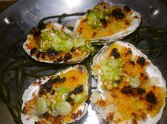 Oysters with crisp bread, scallion, grated jalapeno and sea urchin is a tasty invention at Quality Italian Steakhouse.