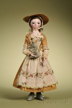 Lot:70: Queen Anne Lady Doll, England, c. 1750, carved wood, Lot Number:70, Starting Bid:$4000, Auctioneer:Skinner , Auction:70: Queen Anne Lady Doll, England, c. 1750, carved wood, Date:04:00 AM PT - Oct 10th, 2009