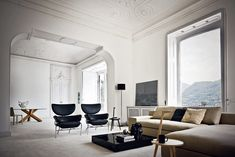 Love this combination of modern furniture including Cassina Tre Pezzi Lounge Chair and Cicognino side table both designers by Franco Albini