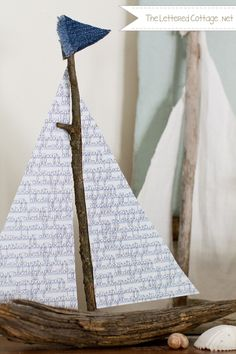 DIY wooden sailboat: It's made out of wood from our backyard, a piece of scrapbook paper from Hobby Lobby, and two little triangles of denim from one of my old pairs of jeans. We just drilled a hole in the middle of the big chunk of wood and filled it with hot glue. While the glue was still wet, we stuck the twig down in it and waited for it to dry. The paper sails and denim flag are also held in place with hot glue. {The Lettered Cottage}