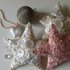 Stitched and stuffed button encrusted Christmas tree star ornaments.