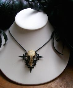 """Gothic Skull Necklace"" - Resin skull on an altered clock hand pendant. (Shop: http://www.etsy.com/people/darklingdoll)"
