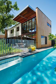 An architect house for an Australian family Sam, architect and his wife Kazia,  turned their 1920s two-bedroom worker's cottage in Perth,  into a modern four-bedroom family retreat.