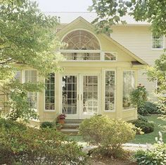 Sunroom with Intricate Roofline - I would love to add a room like this off the back of our house!