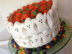 Easy Halloween cake that will work for cupcakes too!  Peeps, candy corn, candy pumpkins and jelly beans decorate a carrot cake covered in cream cheese frosting.